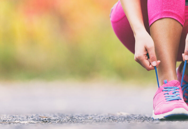 Running,Shoes,Runner,Woman,Tying,Laces,For,Autumn,Run,In